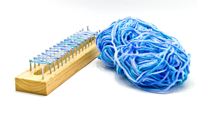 Blue thread and wooden block stock images
