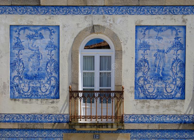 Blue tile facade, Aveiro. Azulejos blue tiles  facade of house. View of top level design of ladies.  Aveiro, Portugal, June 23, 2017 stock photography