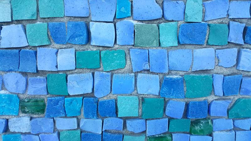 Blue tile mosaic on the wall stock image