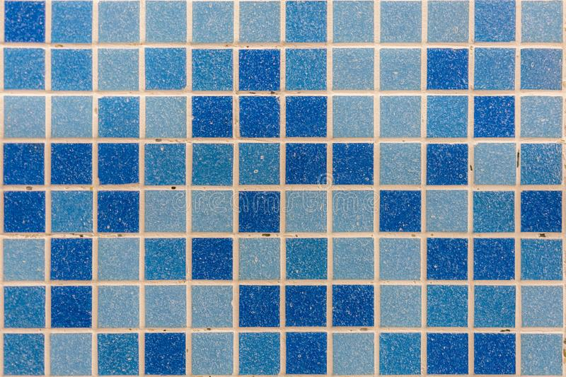 Blue tile wall high resolution real photo. Blue glass mosaic in the bathroom.  stock photo
