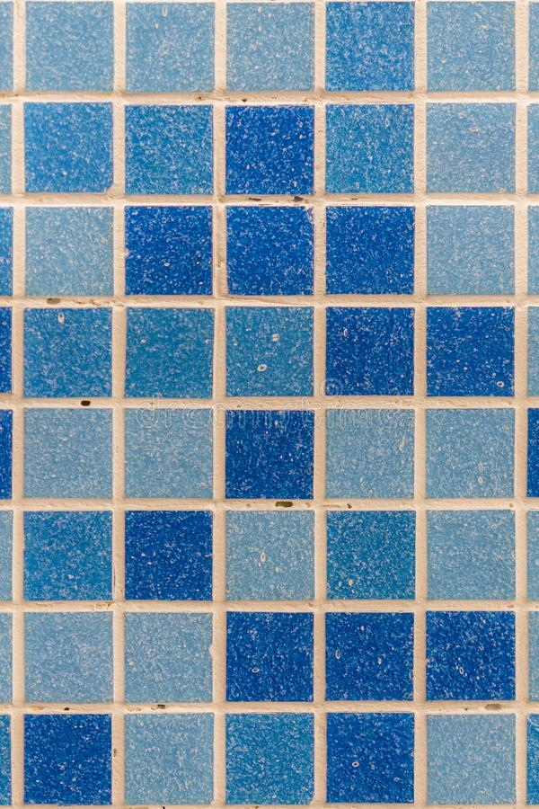 Blue tile wall high resolution real photo. Blue glass mosaic in the bathroom. vertical photo.  stock image