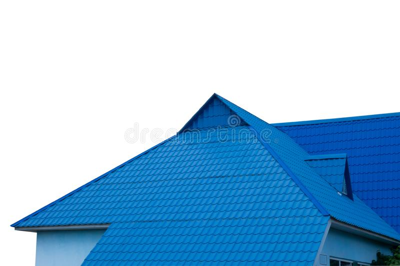 Blue tiled roof of house on white background in day time. Isolated object of modern townhouse or other real estate construction royalty free stock image