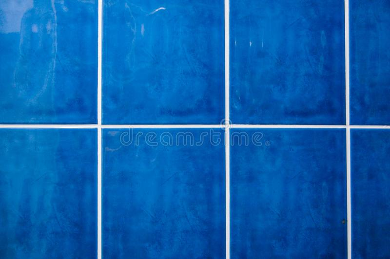 Blue tiles in the bathroom stock images