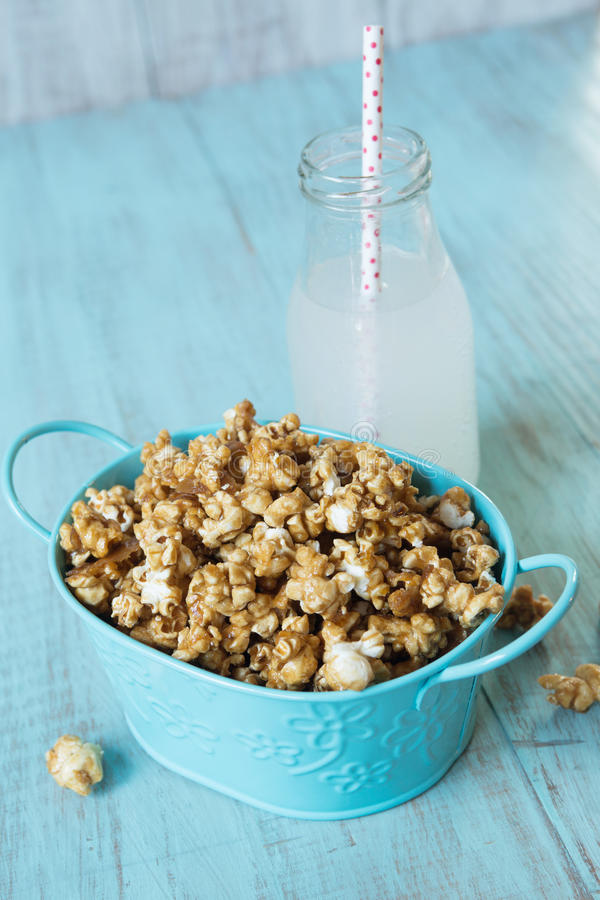 Blue Tin With Caramel Popcorn and Lemon Soda Pop Snack stock photography
