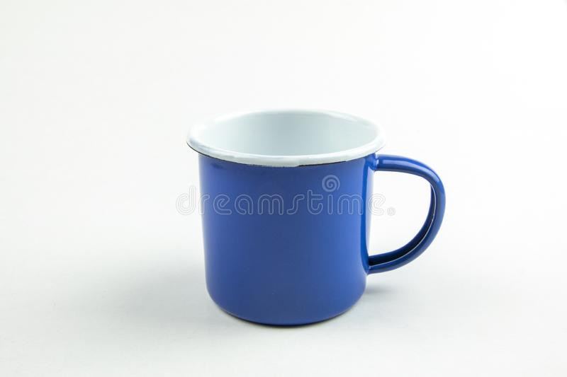 Blue tin cup royalty free stock images