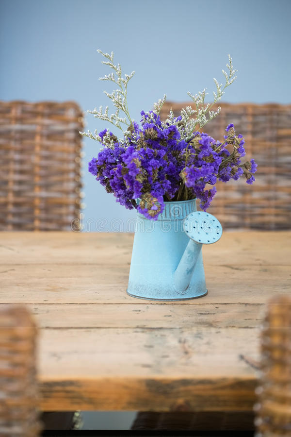 Blue tin watering flower pot royalty free stock photo