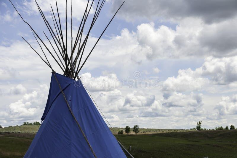 Blue tipi in `big sky` Montana stock photography