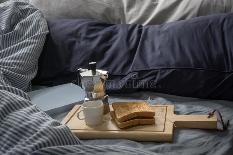 Breakfast in Bed, Book, Espresso and Toast in the Morning royalty free stock images