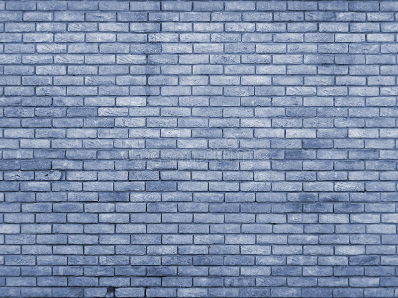 Blue toned brick wall repeating pattern. Blue toned old brick wall with repeating pattern stock photo