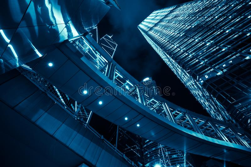 Blue toned modern cityscape at night stock photos