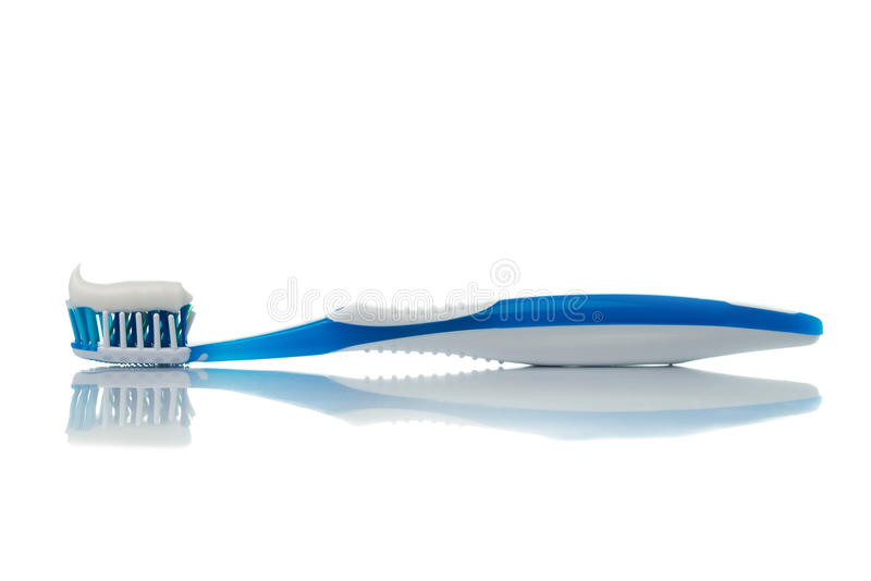 Blue toothbrush. With toothpaste on white background stock image