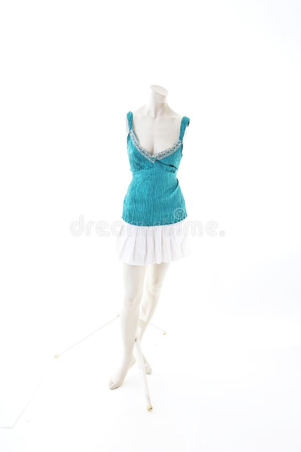 Blue top with mini skirt summer style on mannequin full body shop display. Woman fashion styles, clothes on white studio backgroun. D stock image