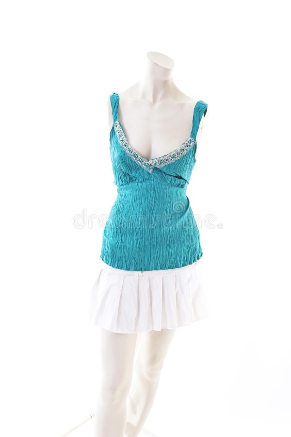 Blue top with mini skirt summer style on mannequin full body shop display. Woman fashion styles, clothes on white studio backgroun. D stock images
