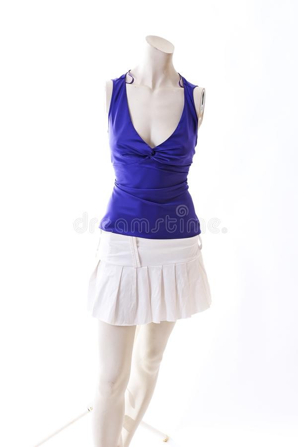 Blue top with mini skirt summer style on mannequin full body shop display. Woman fashion styles, clothes on white studio backgroun. D stock photography