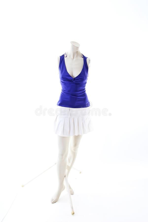 Blue top with mini skirt summer style on mannequin full body shop display. Woman fashion styles, clothes on white studio backgroun. D royalty free stock images