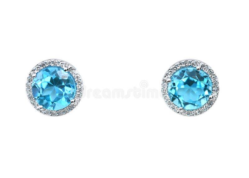 Blue topaz Gemstone and diamond earrings cushion cut with a halo setting. stock image