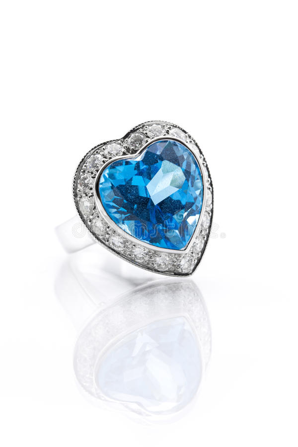 Blue topaz surrounded with diamond ring. Blue topaz in heart shape surrounded with diamond ring vector illustration