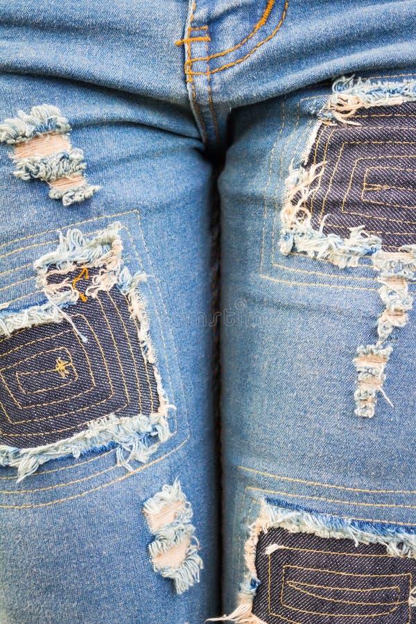 Blue torn denim jeans texture stock photography