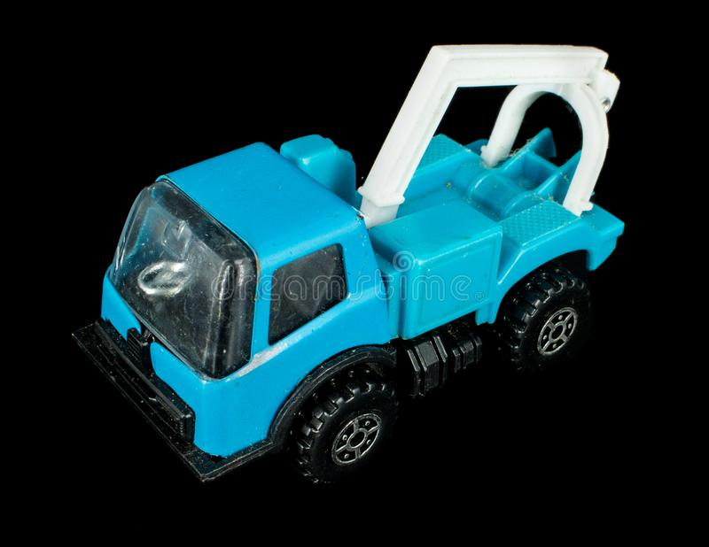 Blue Tow Truck Toy. A generic blue tow truck toy on black background stock image