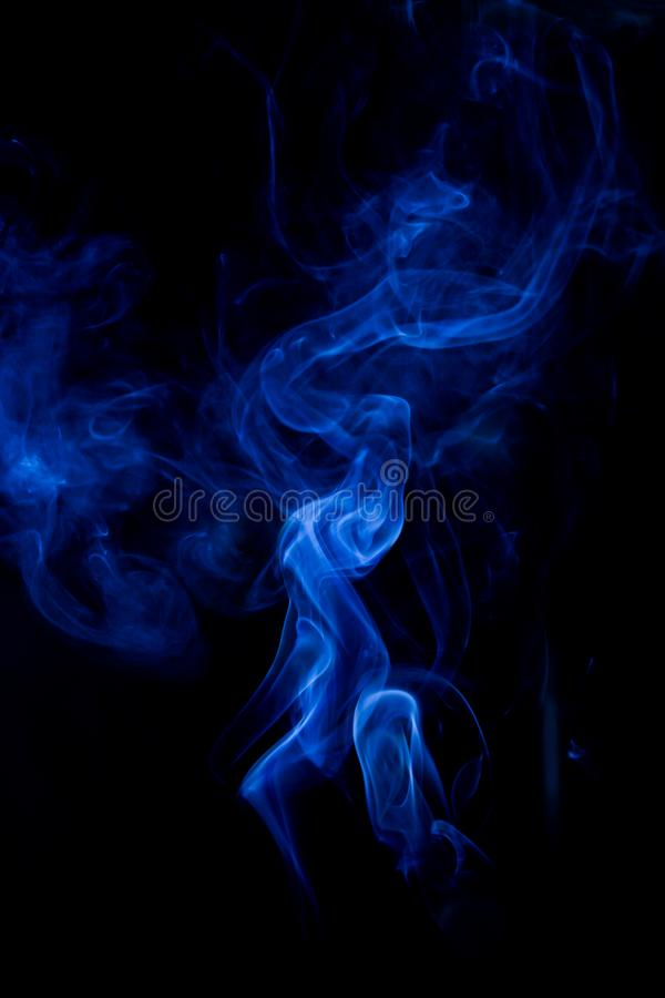 Blue toxic fumes movement on a black background. Abstract, art, beautiful, color, curve, design, flowing, fumigate, light, motion, mystery, nobody, pattern stock photos