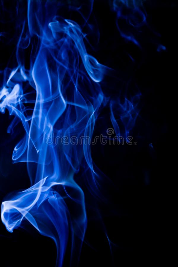 Blue toxic fumes movement on a black background stock images