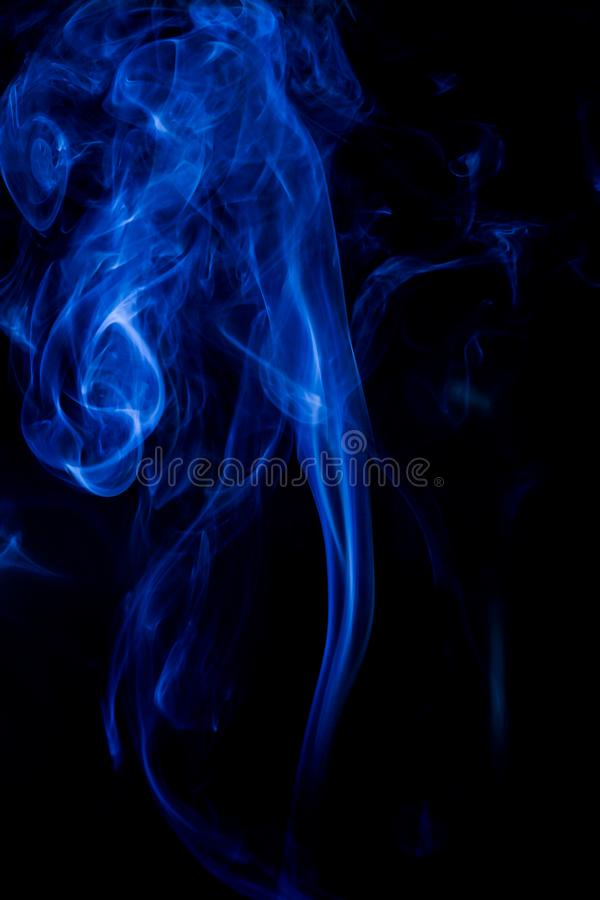 Blue toxic fumes movement on a black background royalty free stock image
