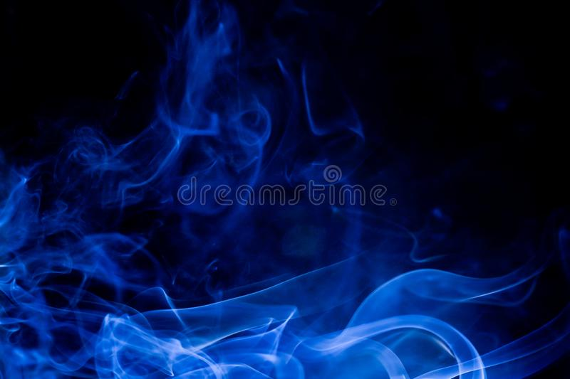 Blue toxic fumes movement on a black background royalty free stock photo