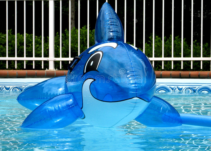 Blue toy. Blue pool toy stock photo