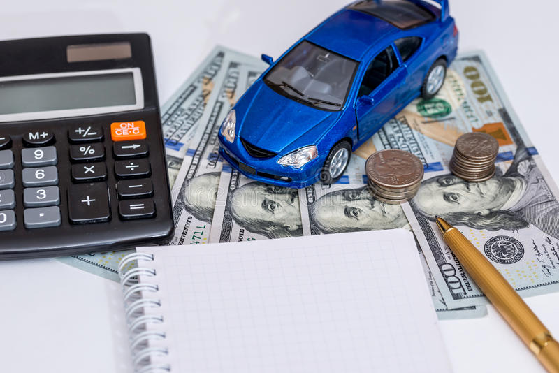 Blue toy car, money. Notepad stock images