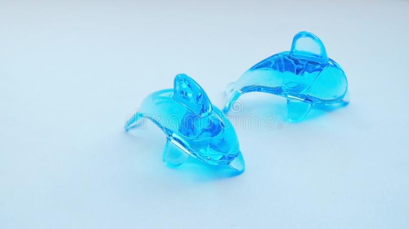 Blue toy dolphin. On a white background stock images