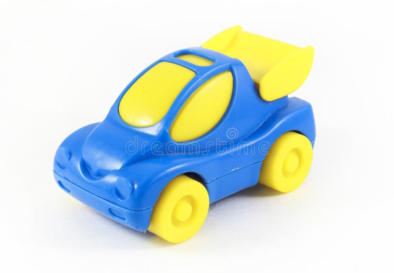 Blue toy plastic car with yellow wheels. Children`s toys, entertainment stock image
