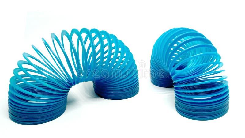 Blue Toy Spring. Isolated On White Background stock image