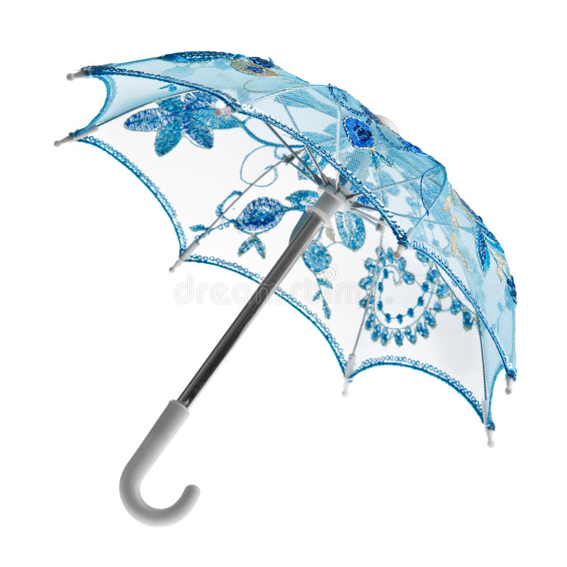 Blue toy umbrella. Blue toy lace parasol isolated on white stock photography