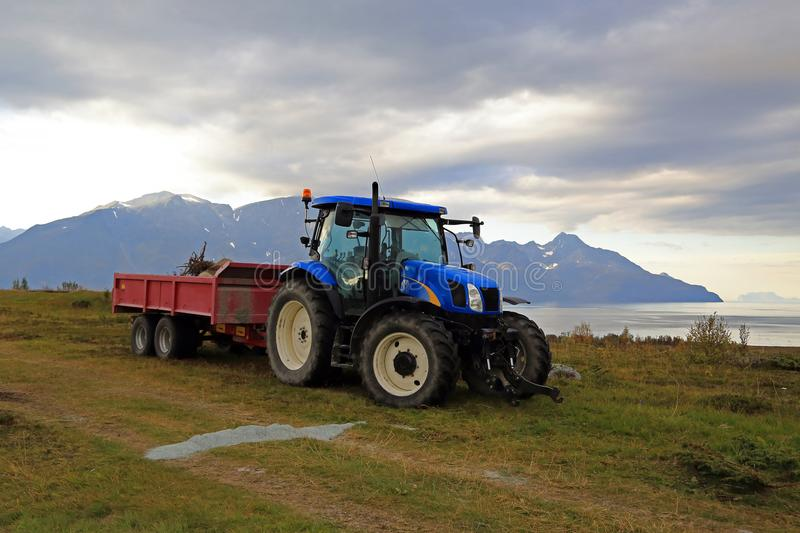 Blue tractor on nature royalty free stock photos