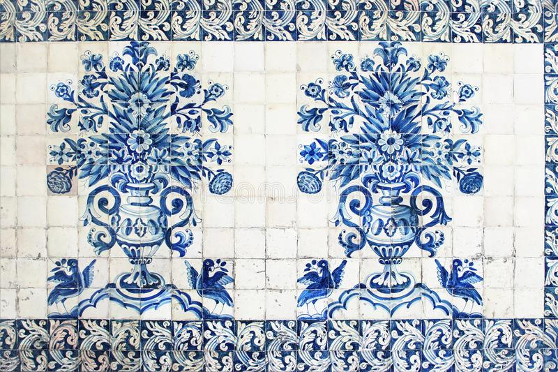 Blue traditional Portuguese ceramic tiles azulejos. Facade, wall decoration of old Coimbra university building, Portugal royalty free stock photos