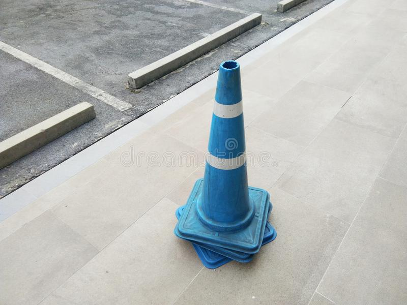 Blue traffic cones on the street. In The City stock photos
