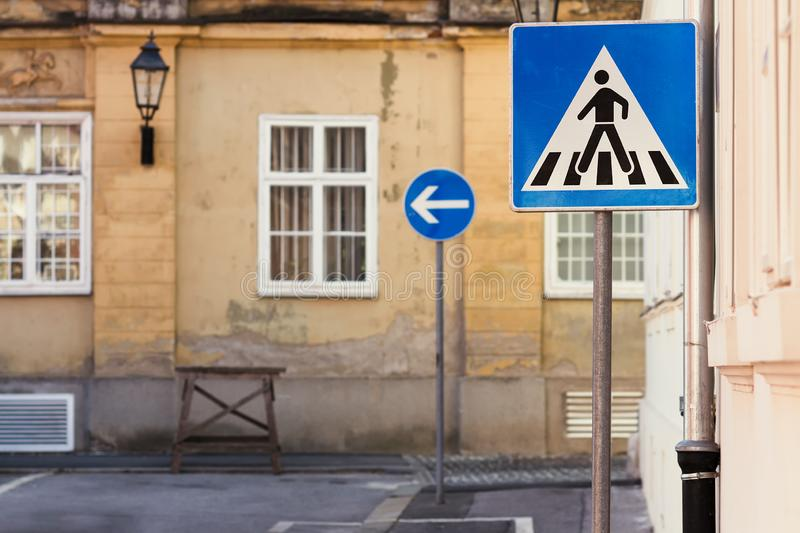 Blue traffic signs in front of an old building royalty free stock photos