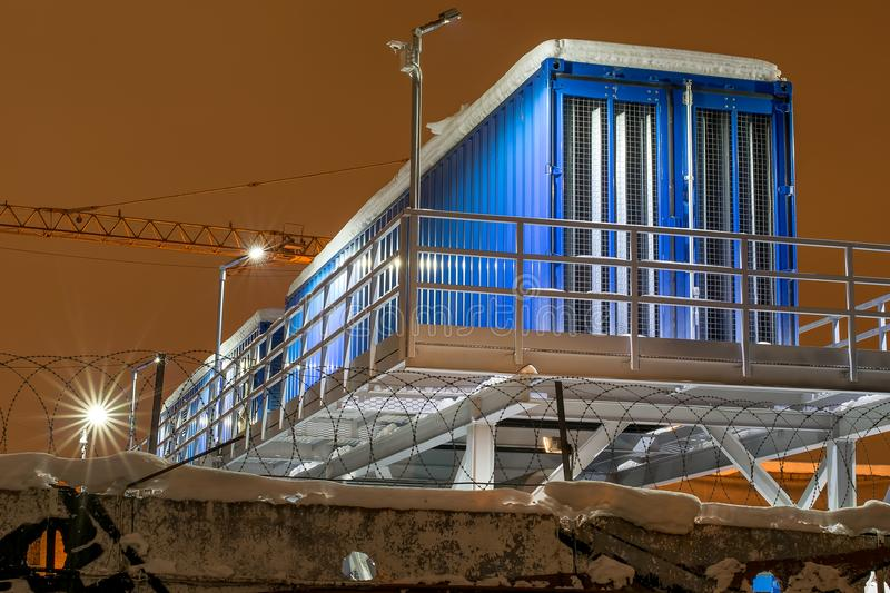 Industrial night landscape, construction of residential boxes of trailers for builders dressing room toilet. Blue trailer locker room for the workers at the stock photos