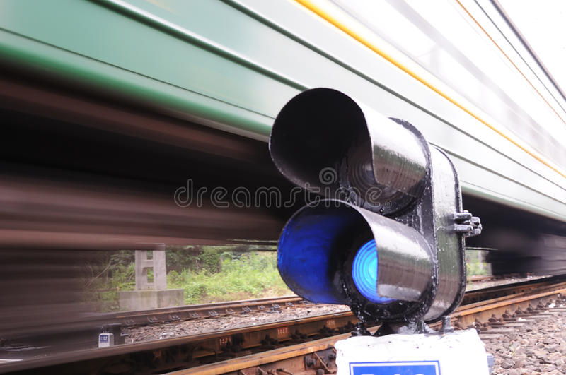 Blue train signal, motion blur stock photo