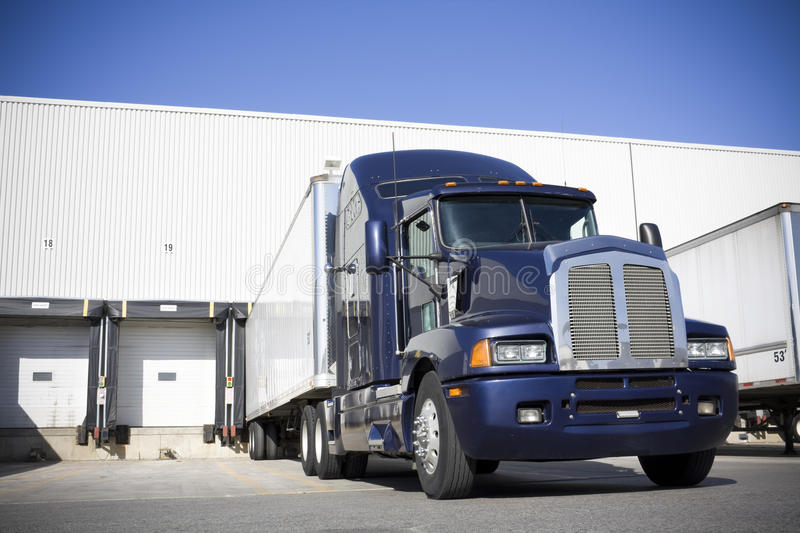 Blue Transport Truck Docking in yard stock photography
