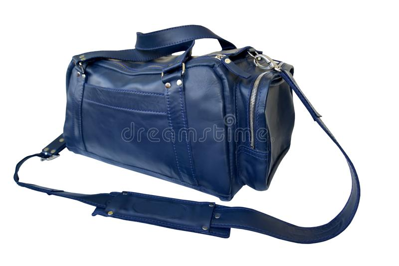 Blue traveling bag with a removable shoulder strap, it is isolated on a white background stock photo