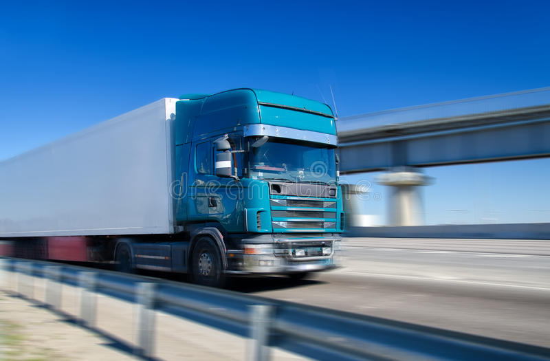 Blue truck driving stock image