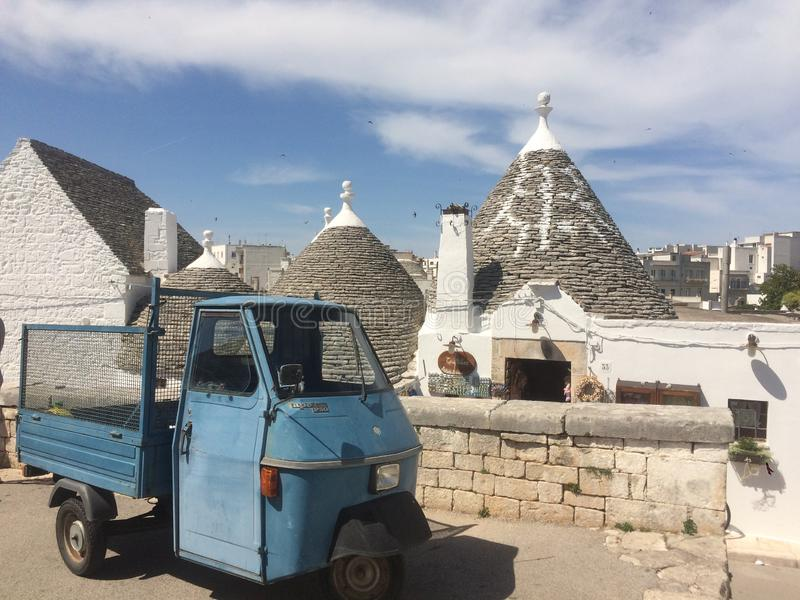 Blue truck and Trulli. In a small village in Italy, Puglia, Alberobello royalty free stock photography