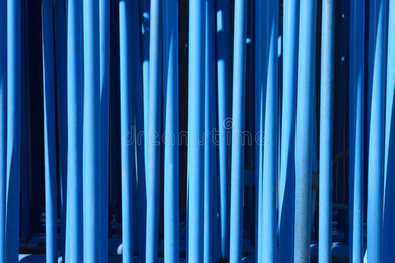 Blue tubular metallic background. Industrial abstract material royalty free stock photos