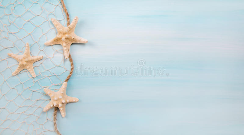 Blue turquoise background with starfishes or shells. royalty free stock image