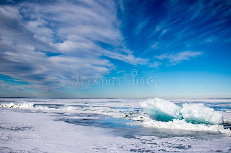 Blue turquoise ice heaves on a frozen lake. Blue turquoise ice heaves on Cold Lake, Alberta, Canada royalty free stock photo