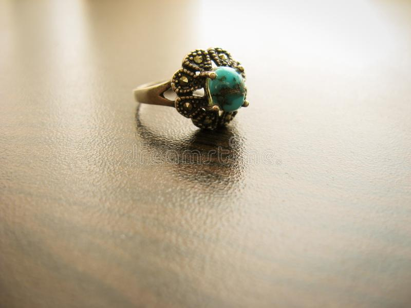Blue turquoise ring Women`s ring. Silver ring decorated with blue turquoise stone stock photos