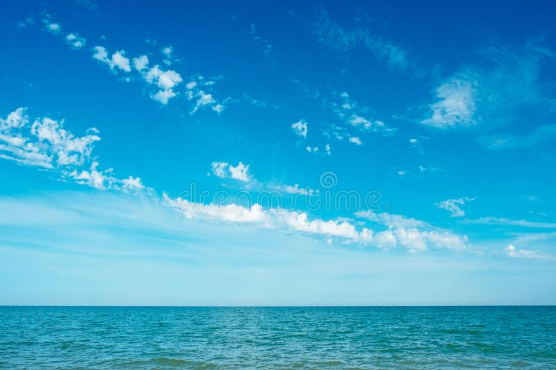 Blue turquoise sea and sky clouds stock photos
