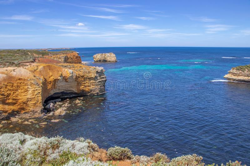 Blue and Turquoise seas off Australian Coast. Strong turquoise colors in blue seas off south coast of Victoria in Australia, taken along the Great Ocean Road royalty free stock photography