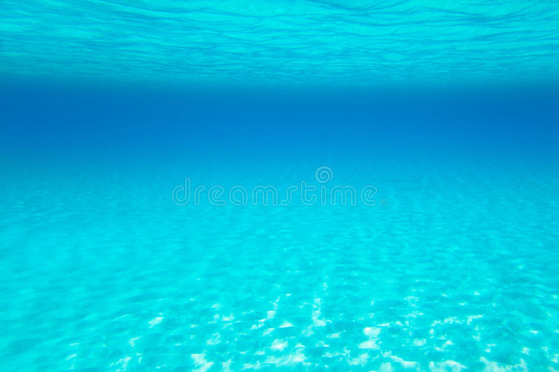 Blue turquoise underwater view of tropical beach royalty free stock photography